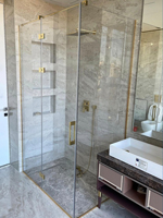 Shower cabins with a hinge